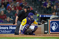 LSU Tigers catcher Alex Milazzo (20) sets a target as home plate umpire Ken Langford looks on during the game against the Oklahoma Sooners in game seven of the 2020 Shriners Hospitals for Children College Classic at Minute Maid Park on March 1, 2020 in Houston, Texas. The Sooners defeated the Tigers 1-0. (Brian Westerholt/Four Seam Images)