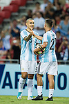 Leandro Paredes of Argentina (R) celebrates a score with Paulo Dybala (L) during the International Test match between Argentina and Singapore at National Stadium on June 13, 2017 in Singapore. Photo by Marcio Rodrigo Machado / Power Sport Images