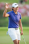 TAOYUAN, TAIWAN - OCTOBER 26:  Yani Tseng of Taiwan acknowledges to the crowd on the 18th hole during the day two of the Sunrise LPGA Taiwan Championship at the Sunrise Golf Course on October 26, 2012 in Taoyuan, Taiwan. Photo by Victor Fraile / The Power of Sport Images