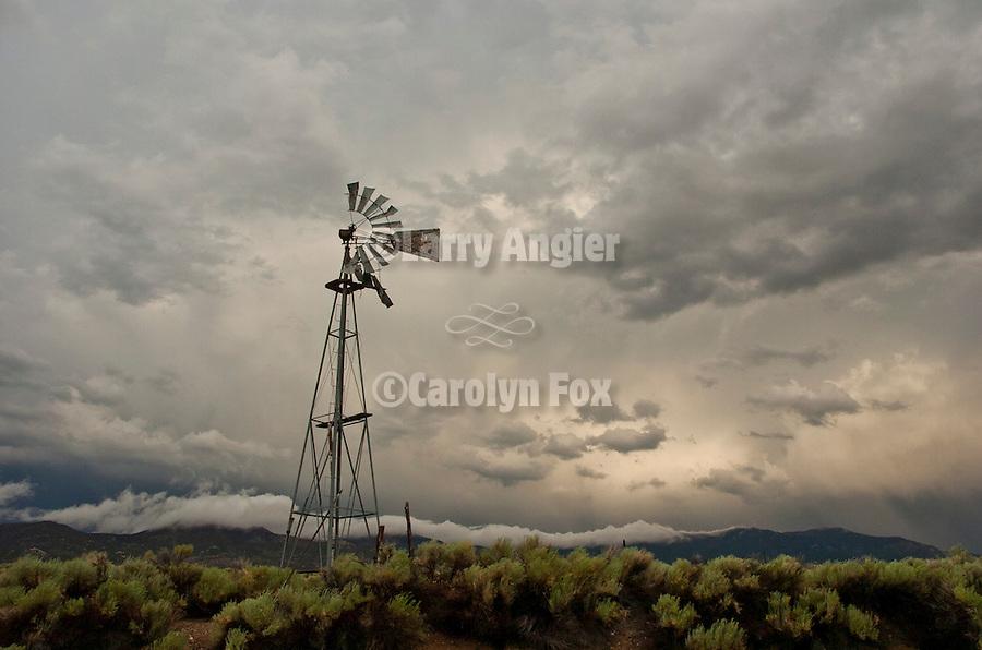 Broken Aermotor windmill in summer storm near the ghost town of Bristol Wells, Nev.