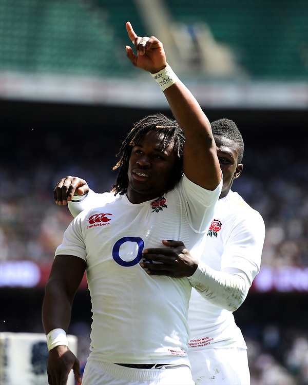 Marland Yarde of England celebrates scoring a try as he is congratulated by Christian Wade of England during the match between England and Barbarians at Twickenham on Sunday 26th May 2013 (Photo by Rob Munro)