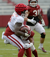 Arkansas running back Raheim Sanders (5) carries the ball Saturday, April 3, 2021, as defensive back Jalen Catalon (1) makes the tackle during a scrimmage at Razorback Stadium in Fayetteville. Visit nwaonline.com/210404Daily/ for today's photo gallery. <br /> (NWA Democrat-Gazette/Andy Shupe)