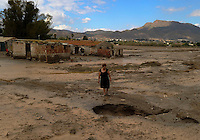 Maria, a resident of the southern city of Lorca, looks at a flooded street of Lorca, near Murcia, southeastern Spain, on September 30, 2012. Ten people in total have died in Spain in the regions of Andalusia and Murcia due to flash flooding brought on by downpours. The heavy rains have also damaged homes, caused the collapse of two bridges and forced roads to close. (c) Pedro ARMESTRE