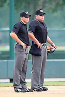 Base umpire J.J. Bilinski (left) and home plate umpire Jorge Teran (right) before a game between the GCL Braves and GCL Pirates at Disney Wide World of Sports on June 25, 2011 in Kissimmee, Florida.  The Pirates defeated the Braves 5-4 in ten innings.  (Mike Janes/Four Seam Images)