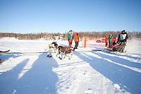 Shameka Nelson leaves the start line of the Junior Iditarod  at Knik Lake, Knik, Alaska