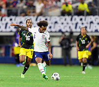 DALLAS, TX - JULY 25: Gianluca Busio #6 of the United States takes a shot at the Jamaica goal during a game between Jamaica and USMNT at AT&T Stadium on July 25, 2021 in Dallas, Texas.