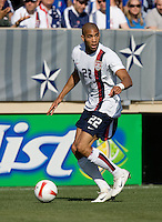 Oguchi Onyewu holds the ball. The USA defeated China, 4-1, in an international friendly at Spartan Stadium, San Jose, CA on June 2, 2007.