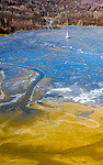 Church is submerged in yellow lake caused by copper mining by Ovi Pop