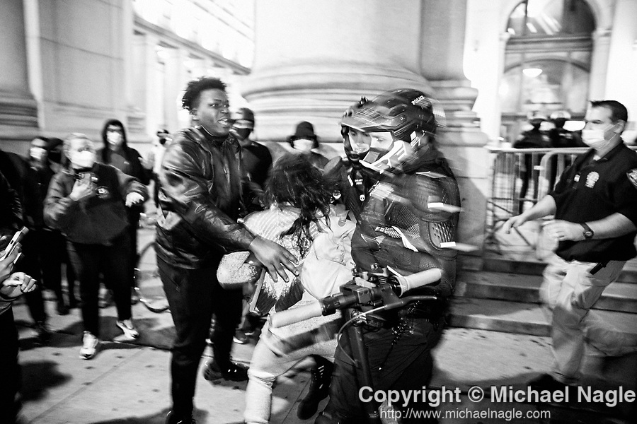NEW YORK, NY — OCTOBER 27, 2020:  NYPD police officers arrest a demonstrator protesting against police brutality, in response to the shooting of Walter Wallace Jr. by Philadelphia police officers the prior day, across from City Hall on October 27, 2020 in New York City.  The confrontation, recorded on a now viral video posted to social media, shows Wallace, a 27 year-old Black man who family members said was in the midst of a mental health crisis, holding a knife as two police officers shot and killed him.  Photograph by Michael Nagle