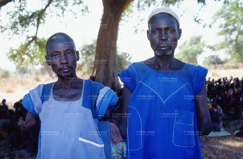 Sudan. South Sudan. Bahr El Ghazal. Yargot. Both men are dinka and had both theirs arms amputated by arab raiders from north Sudan. Christian Solidarity International (CSI) buys back their slaved family from muslim arab traders. © 1999 Didier Ruef