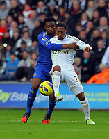 Saturday, 03 November 2012<br /> Pictured: Jonathan de Guzman of Swansea (R) is brought down by John Obi Mikel of Chelsea (L)<br /> Re: Barclays Premier League, Swansea City FC v Chelsea at the Liberty Stadium, south Wales.