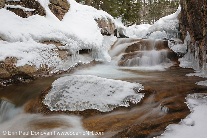 """The Baby Flume on the Pemigewasset River in Franconia Notch State Park in Lincoln, New Hampshire covered in snow. This water feature is located a short ways down river from the """"The Basin"""" viewing area."""