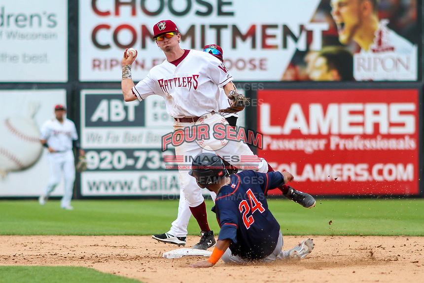 Wisconsin Timber Rattlers shortstop Trever Morrison (13) makes a throw to first base during a Midwest League game against the Bowling Green Hot Rods on July 23, 2018 at Fox Cities Stadium in Appleton, Wisconsin. Wisconsin defeated Bowling Green 5-3. (Brad Krause/Four Seam Images)