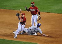 Apr. 8, 2008; Phoenix, AZ, USA; Arizona Diamondbacks second baseman (6) Stephen Drew cant complete the double play after being pressured by a sliding Los Angeles Dodgers base runner James Loney at Chase Field. Mandatory Credit: Mark J. Rebilas-