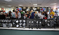 Pictured: A long queue of supporters at the club shop tills, to be the first to buy the new shirts. Saturday 21 June 2014<br /> Re: Launch of the new home and away kit for Swansea City Football Club at the Liberty Stadium, south Wales.