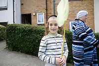 An Hasidic boy gets ready to go to the beach. Hasidic families stay in Pentre Jane Morgan university accommodation when they holiday in Aberystwyth. Every other day, bread, milk and other supplies are brought from Kosher shops in London and resold from one of the rented houses on the campus.