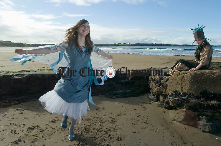 3rd year Spanish Point Secondary school pupil Roisin Lillis and Lorraine Dooley modelling outfits on the beach in preparation for their fashion show in aid of the school fund and charity which takes place on 13th October in the Armada Hotel. Photograph by John Kelly.