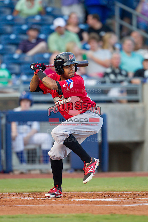 Frisco RoughRiders pitcher Alex Gonzalez (23) takes aim at a pitch during the Texas League game against the Tulsa Drillers at ONEOK field on August 15, 2014 in Tulsa, Oklahoma  The RoughRiders defeated the Drillers 8-2.  (William Purnell/Four Seam Images)