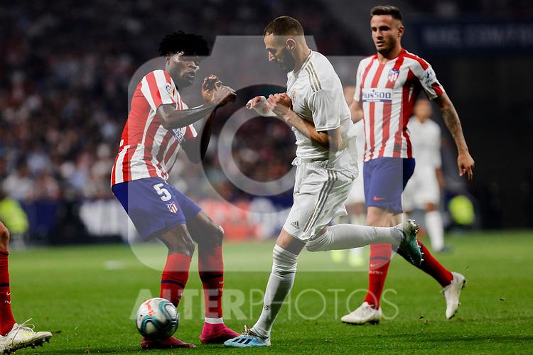 Thomas Teye of Atletico de Madrid and Karim Benzema of Real Madrid during La Liga match between Atletico de Madrid and Real Madrid at Wanda Metropolitano Stadium in Madrid, Spain. September 28, 2019. (ALTERPHOTOS/A. Perez Meca)
