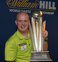13.06.2014. London, England.  Rileys Sports Bar, Haymarket. The  launch of William Hill's sponsorship as title sponsor of the 2015 World Darts Championship. Reigning World Darts Champion Michael van Gerwen with the Sid Waddell Trophy.