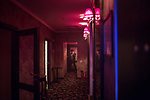 A stuff member of Moscow Marusya, night club for women leaves one of a private club's rooms. Moscow. Russia. 2014