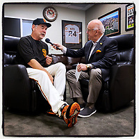 SAN FRANCISCO, CA - SEPTEMBER 29: iPhone Instagram manager Bruce Bochy of the Giants conducting his daily radio show with broadcaster Jon Miller from KNBR in his office before his last game ever as Giants manager before the game between the Philadelphia Phillies and San Francisco Giants at Oracle Park on September 29, 2019 in San Francisco, California. (Photo by Brad Mangin)