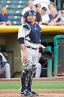 Humberto Quintero (35) of the Tacoma Rainiers during the game against the Salt Lake Bees in Pacific Coast League action at Smith's Ballpark on July 8, 2014 in Salt Lake City, Utah.  (Stephen Smith/Four Seam Images)