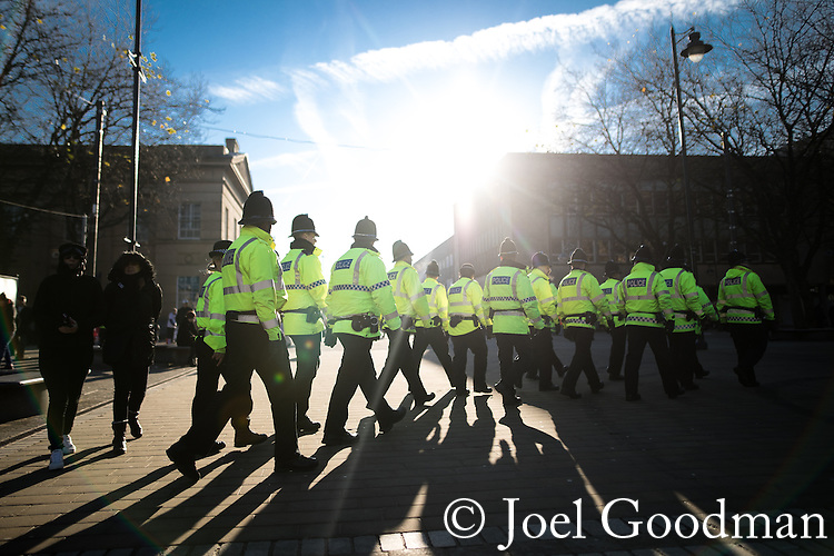 "© Joel Goodman - 07973 332324 . 26/11/2016 . Bolton , UK . Police at the demonstration . Approximately 100 people attend a demonstration against the construction of mosques in Bolton , under the banner "" No More Mosques "" , organised by a coalition of far-right organisations and approximately 150 anti fascists opposing the demonstration , in Victoria Square in Bolton Town Centre . Photo credit : Joel Goodman"