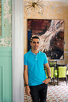 Artist Damian Aquiles at home in Havana