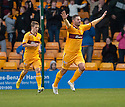 Motherwell's Michael Higdon celebrates after he scores Motherwell's first goal...