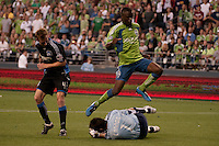 Steve Zakuani (c ) flies over Joe Cannon (below)  as Chris Leitch (l) defends in the Seattle Sounders 2-1 win against San Jose Earthquake on Saturday, June 13, 2009 at Quest Field in Seattle, WA.