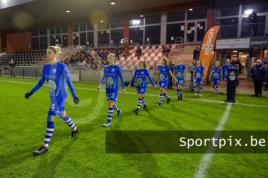 Team AA Gent entering the field before a female soccer game between  AA Gent Ladies and Standard Femina de Liege on the 8 th matchday of the 2020 - 2021 season of Belgian Scooore Womens Super League , friday 20 th of November 2020  in Oostakker , Belgium . PHOTO SPORTPIX.BE | SPP | STIJN AUDOOREN