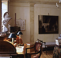 An English roll-top writing desk dominates one wall of the atelier living room.  The painting on the easel is by Bei, a Danish artist, of artists at work in the Royal Academy in Copenhagen (1815)