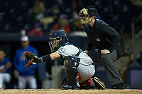 Gwinnett Braves catcher Raffy Lopez (53) sets a target as home plate umpire Richard Riley looks on during the game against the Durham Bulls at Durham Bulls Athletic Park on April 20, 2019 in Durham, North Carolina. The Bulls defeated the Braves 3-2 in game two of a double-header. (Brian Westerholt/Four Seam Images)