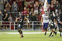 STANFORD, CA - October 5, 2013:  Stanford Cardinal linebacker AJ Tarpley (17) runs back a interception during the Stanford Cardinal vs the Washington Huskies at Stanford Stadium in Stanford, CA. Final score Stanford Cardinal 31, Washington Huskies  28.