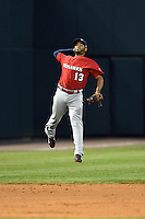 Oklahoma City RedHawks shortstop Gregorio Petit (13) makes a leaping thrown to first during a game against the Memphis Redbirds on May 23, 2014 at AutoZone Park in Memphis, Tennessee.  Oklahoma City defeated Memphis 12-10.  (Mike Janes/Four Seam Images)