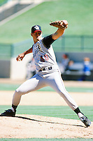 Darrin Babineaux of the San Bernardino Stampede pitches during  a game against the Lake Elsinore Storm during the 1996 baseball season at The Diamond in Lake Elsinore, California. (Larry Goren/Four Seam Images)