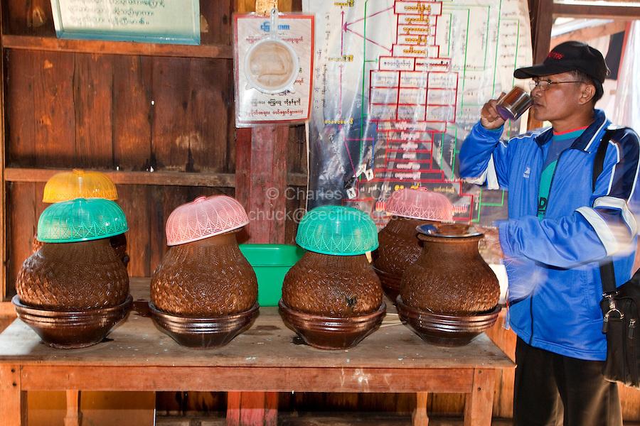 Myanmar, Burma.  Drinking Water for Visitors, Nga Hpe Kyaung (Jumping Cat) Monastery, Buddha Shrine, Inle Lake, Shan State.