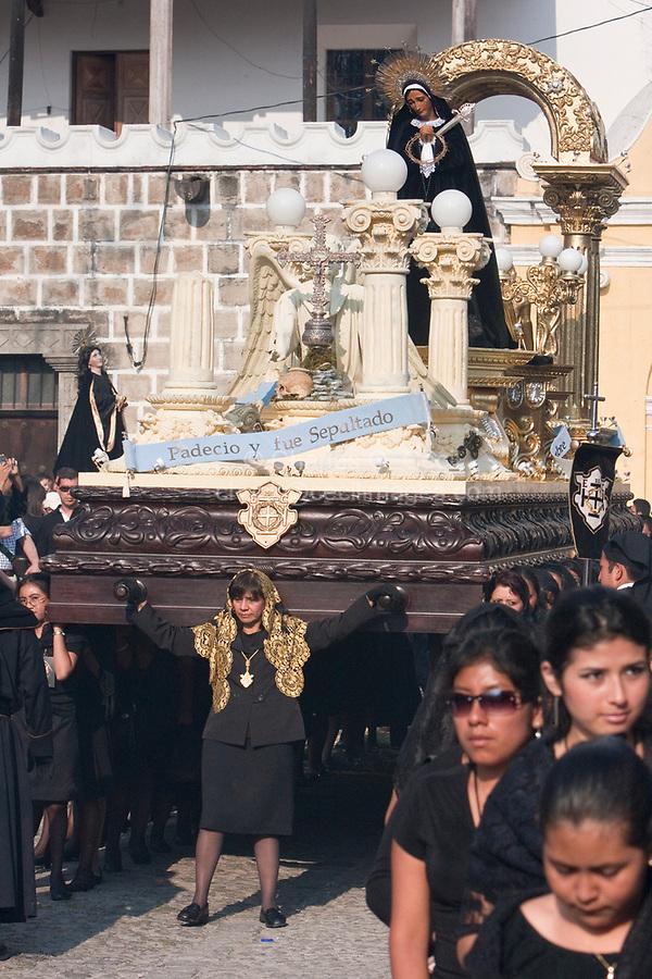 Antigua, Guatemala.  Holy Saturday.  Women Carrying a Float (Anda) in the  Procession of the Virgin of Solitude (Virgen de Soledad), Holy Week, La Semana Santa.