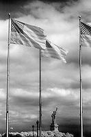 Statue Of Liberty through a row of flags&#xA;<br />
