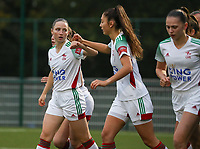 (Left to right)  Estee Cattoor of OHL (11) gives a fist bump to Amber Tysiak of OHL (3) during a female soccer game between Oud Heverlee Leuven and Femina White Star Woluwe  on the 5 th matchday of the 2020 - 2021 season of Belgian Womens Super League , Sunday 18 th of October 2020  in Heverlee , Belgium . PHOTO SPORTPIX.BE | SPP | SEVIL OKTEM