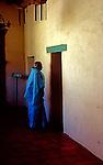 Woman enters Catholic Mission San Juan Batista in California near San Jose.
