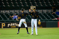 Bradenton Marauders pitcher Santiago Florez (50) and first baseman Endy Rodriguez (5) celebrate after the final out of a game against the Daytona Tortugas on June 9, 2021 at LECOM Park in Bradenton, Florida.  (Mike Janes/Four Seam Images)