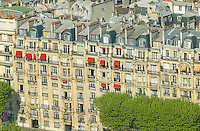Birds eye view of adjacent buildings and roof tops from the observation deck of the Eiffel Tower, Paris, France