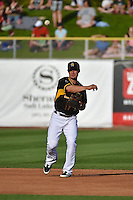 Tommy Field (12) of the Salt Lake Bees on defense against the Reno Aces in Pacific Coast League action at Smith's Ballpark on July 23, 2014 in Salt Lake City, Utah.  (Stephen Smith/Four Seam Images)