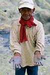 Sulphur miner, Kawah Ijen, Java, Indonesia, 2002.