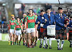 Fergal Lynch of Clooney-Quin leads out his team for their senior county final replay against Sixmilebridge at Cusack park. Photograph by John Kelly.