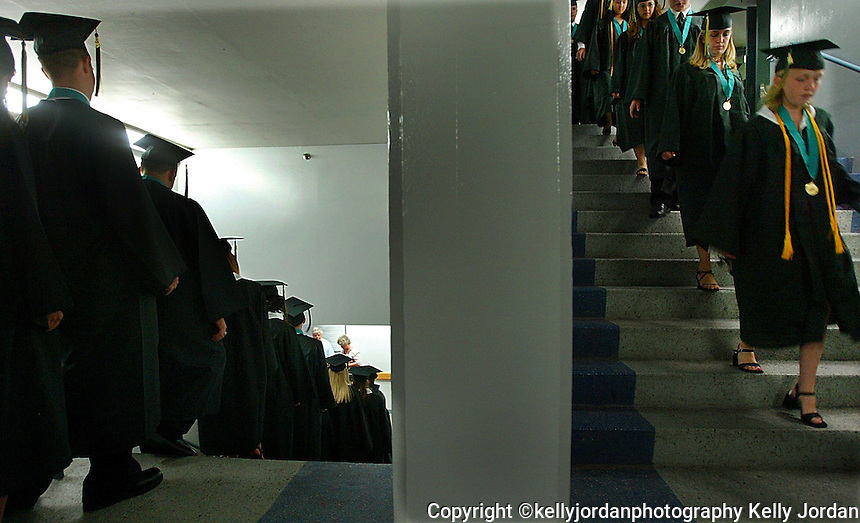 Pine Ridge High School graduates walk in line to begin the graduation ceremonies for the Class of 2004 Sunday afternoon, May 23, 2004 at the Ocean Center in Daytona Beach, Florida.(AP Photo/Daytona Beach News-Journal, kelly Jordan)