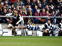 Photo: Richard Lane/Richard Lane Photography. London Wasps v Bath Rugby. Amlin Challenge Cup Semi Final. 27/04/2014. Wasps' Elliot Daly breaks past Bath's Matt Banahan.