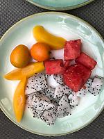 Nanjing, Jiangsu, China.  Breakfast Fruit Dish:  Kumquats, Watermelon, Dragon Fruit, Peaches.